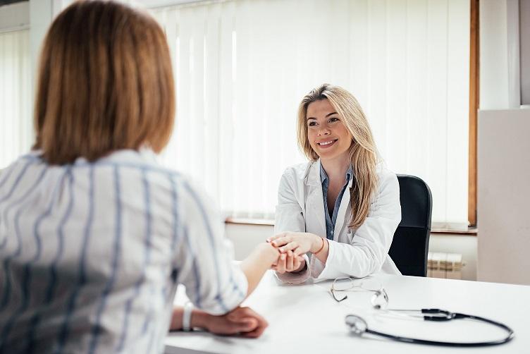 Friendly doctor reasuring her patient.